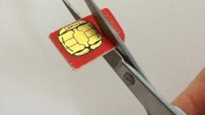 SIM card being cut with scissors
