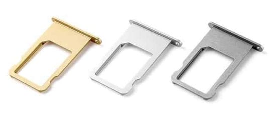 iPhone SIM trays in gold, silver, and space gray.