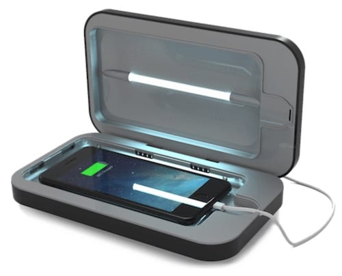 Smartphone getting disinfected with UV light by a PhoneSoap gadget.