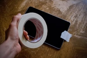Masking tape attached over an iPad home button.