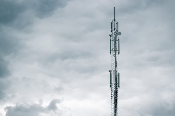 Photograph of a radio tower in front of a cloudy sky