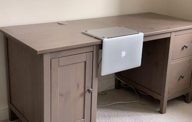 MacBook resting upside down on a desk