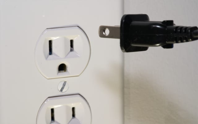 Power cable being unplugged from outlet