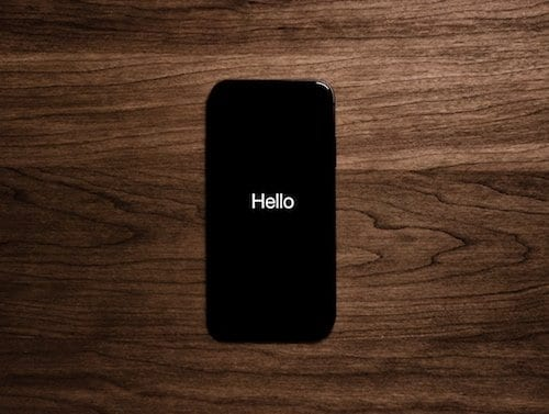 "Photo of an iPhone 7 saying ""Hello"" on the Welcome screen"