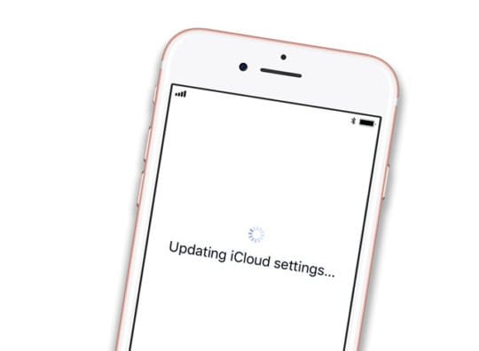 iPhone with Updating iCloud Settings on White Set Up Screen