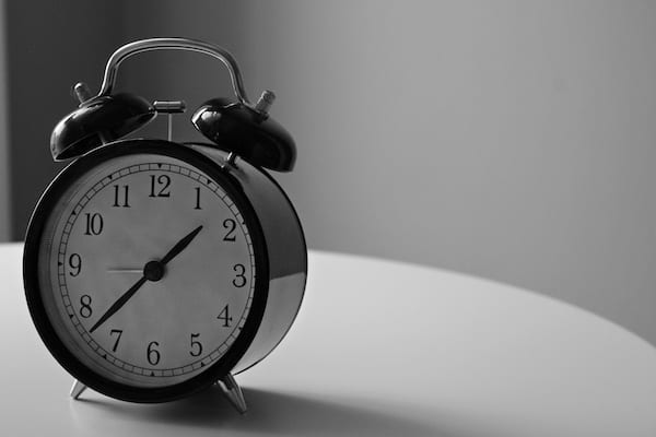 Black and white photo of a twin bell alarm clock