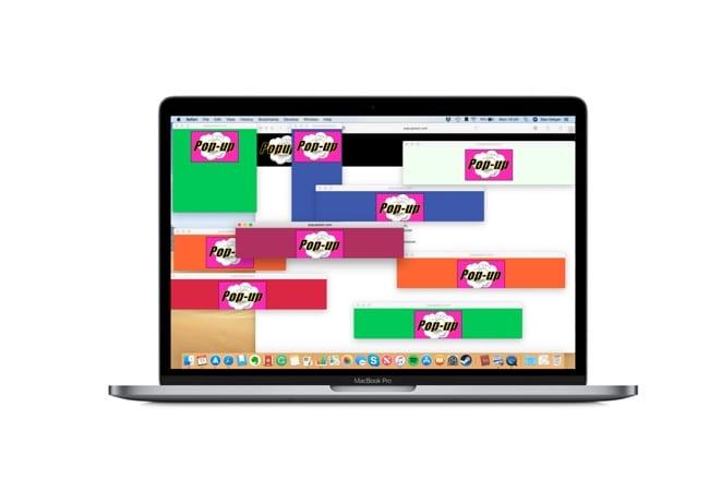 Photo of a MacBook showing multiple Safari pop-ups