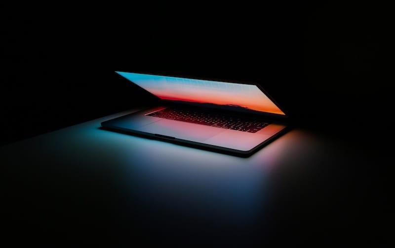 MacBook Pro 15-inch light in dark room