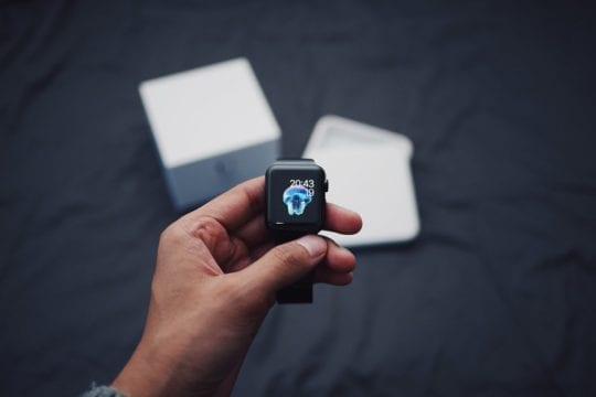 Holding new Apple Watch