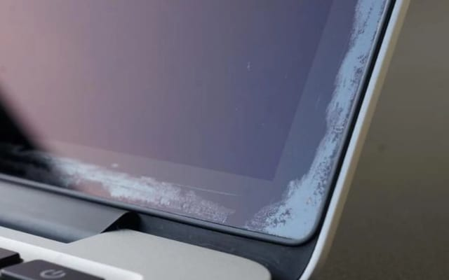 MacBook screen with delamination stains2
