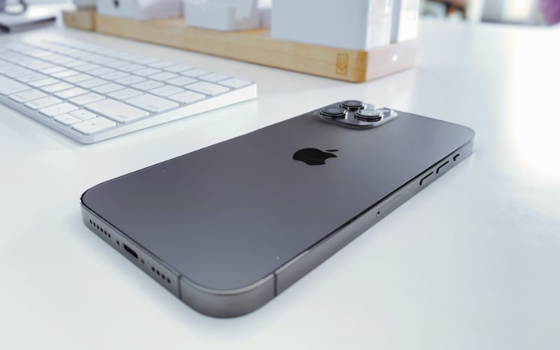 iPhone 12 lying face down on a desk