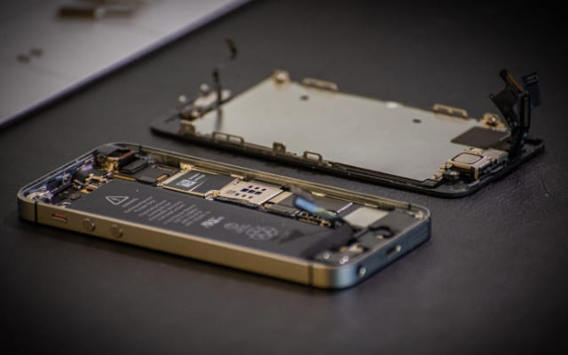 iPhone mid-repair with screen removed