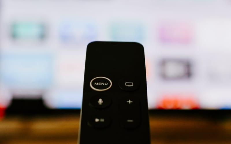 Apple TV Siri Remote pointed at TV