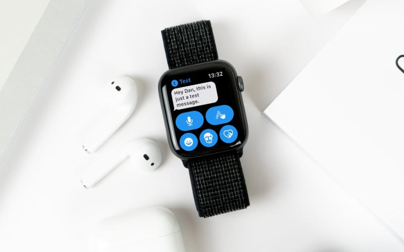 Apple Watch receiving message next to AirPods