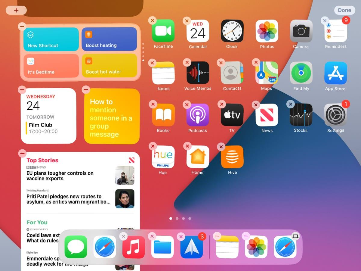 iPad Home Screen widgets in Wiggle mode.